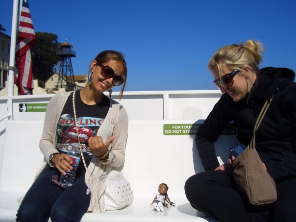 Hanging out with a travel pal's mascot on the ferry to Alcatraz